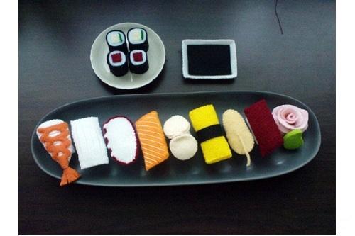 Sushi felt food on a black plate