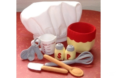 A baking felt set with cooking utensils, measuring cup and bowl