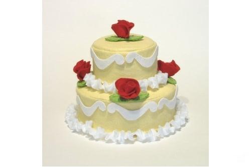 a 2 tier felt cake with felt decorations