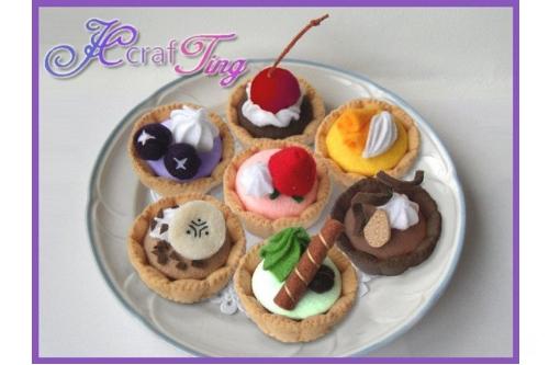 7 felt fruit tarts on a plate