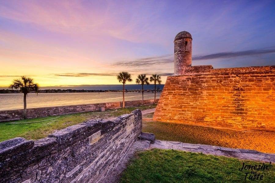 castillo de san marcos lit at sunset