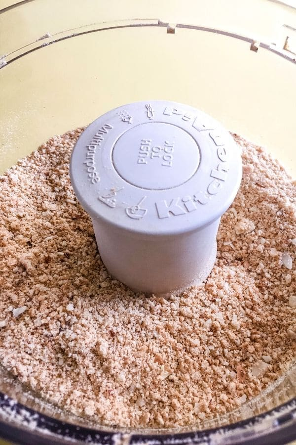 processed graham crackers and macadamia nuts in a food processor
