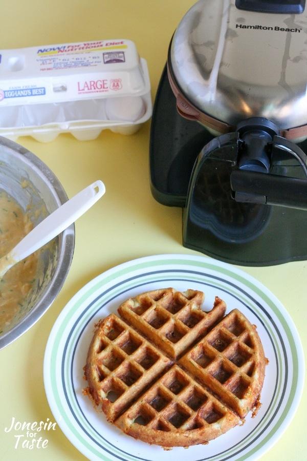 A cornmeal waffle on a white plate