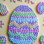 An Easter Egg cookie pizza with several mini Easter egg cookies