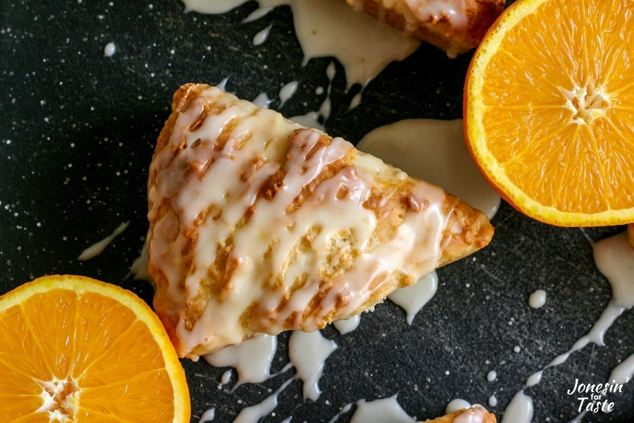 An orange yogurt scone drizzled with icing