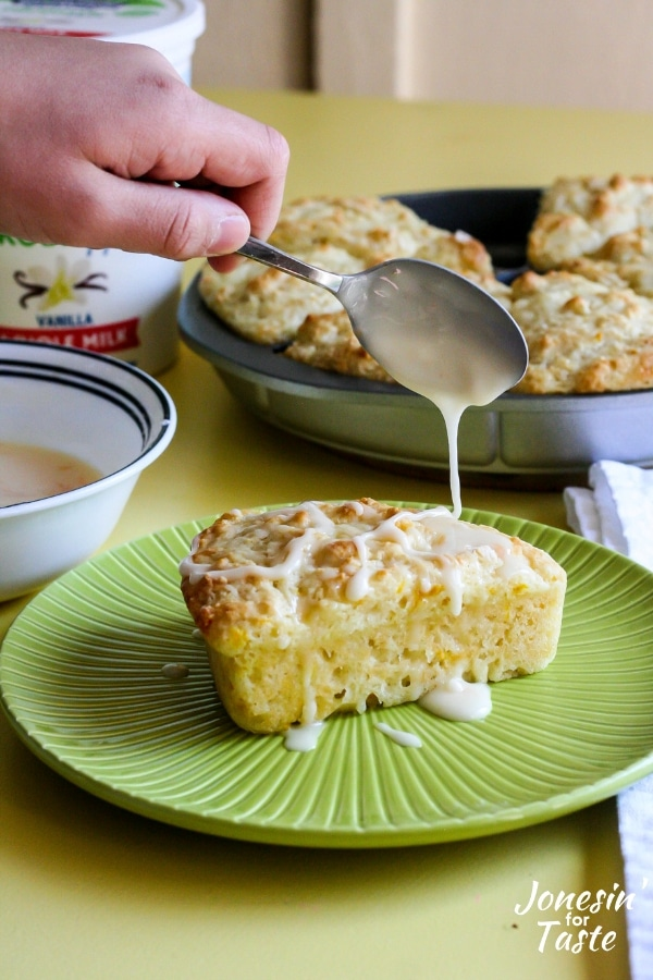Drizzling icing onto a scone