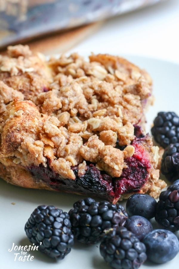 Layers of french toast and berries topped with oatmeal crumble