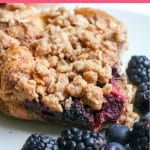 A square of french toast bake on a plate with berries