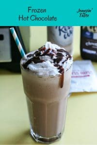 A cup of frozen chocolate in front of the ingredients you need to make it