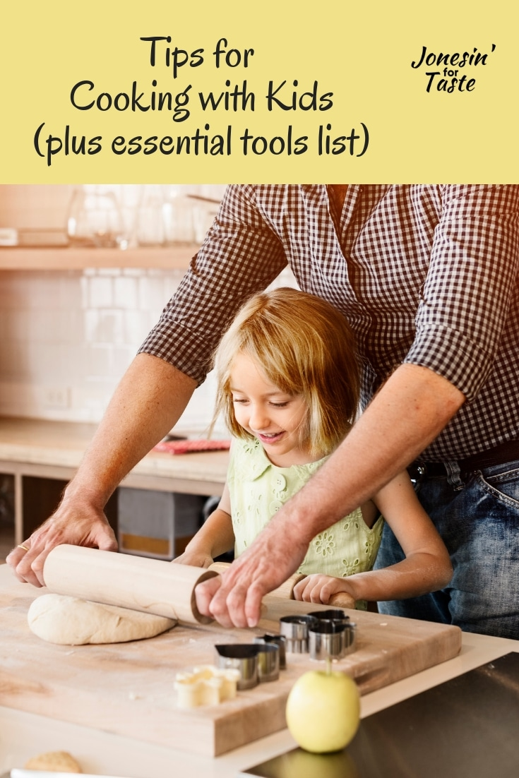 A girl using a rolling pin with her dad
