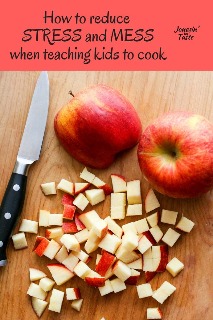 a paring knife next to chopped red apples