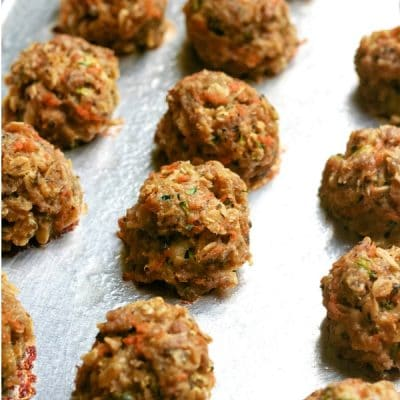 cooked meatballs on a cookie sheet