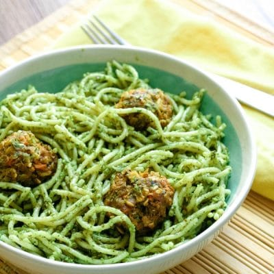 A bowl of lemon pesto spaghetti with meatballs