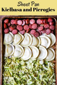 kielbasa, pierogies, and cabbage on a cookie sheet