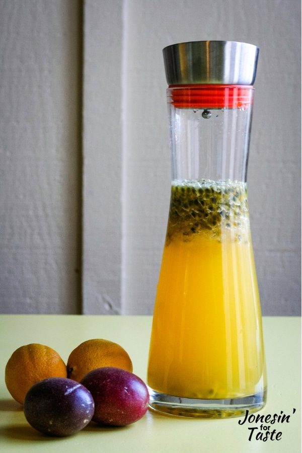 a pitcher of passion fruit lemonade on a yellow table