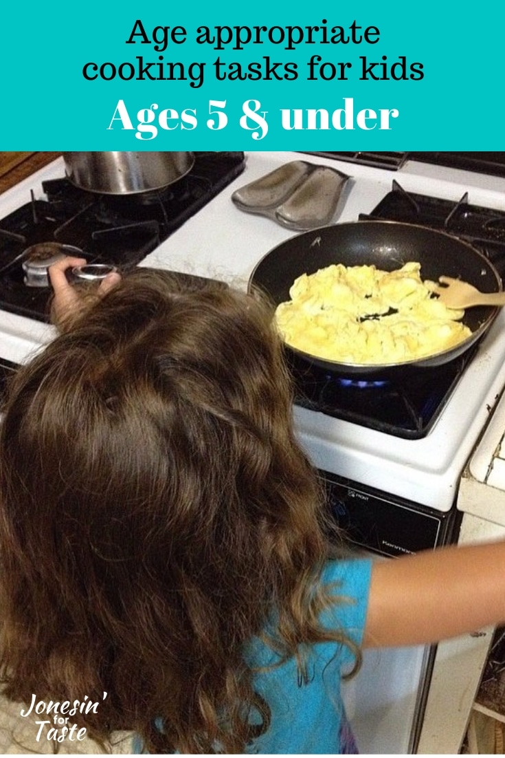 A young girl cooking scrambled eggs on the stove