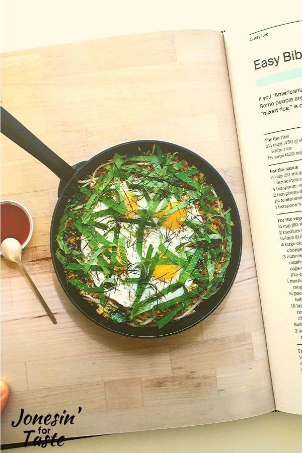 a cookbook page showing a pan of bibimap