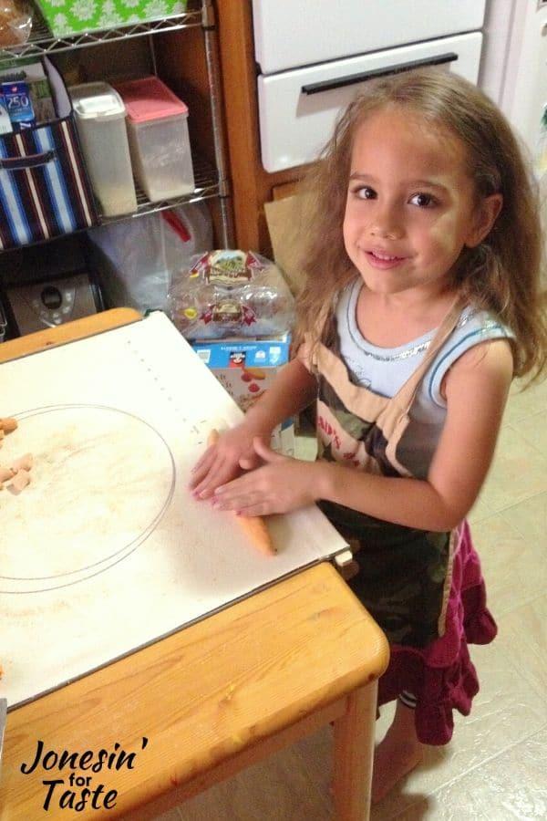 a child making pasta