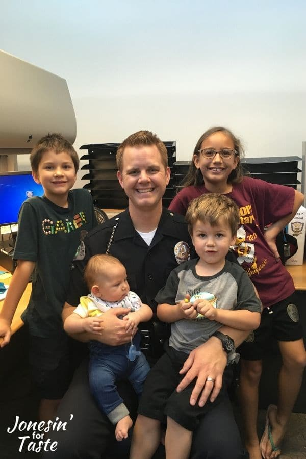 my husband in his LAPD uniform and our 4 children