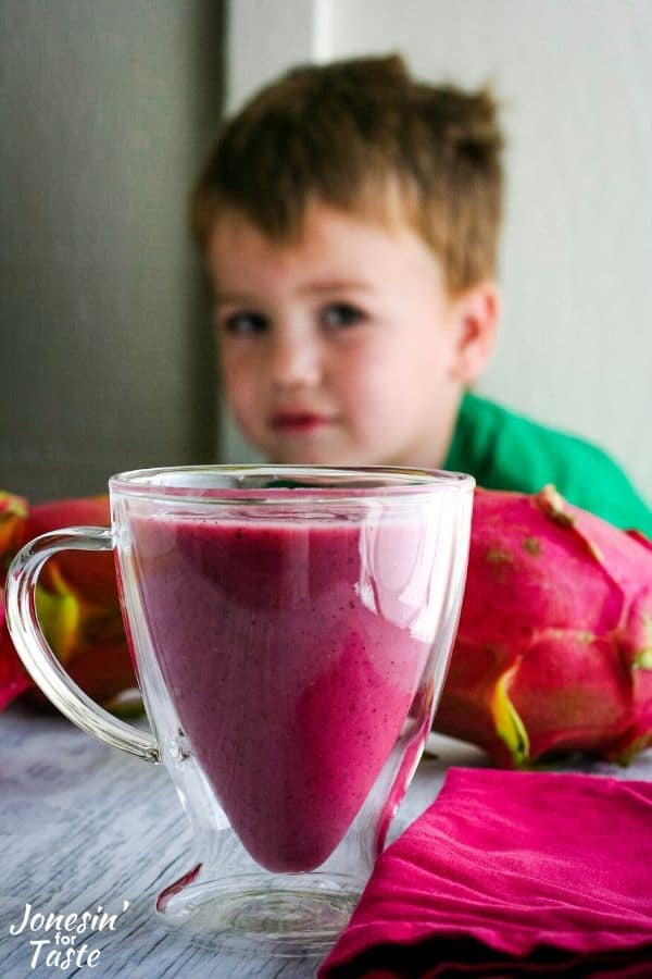 my son eyeing a cup full of smoothie