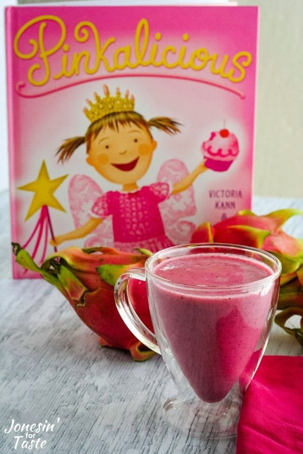 a cup of pink smoothie in front of the book pinkalicious