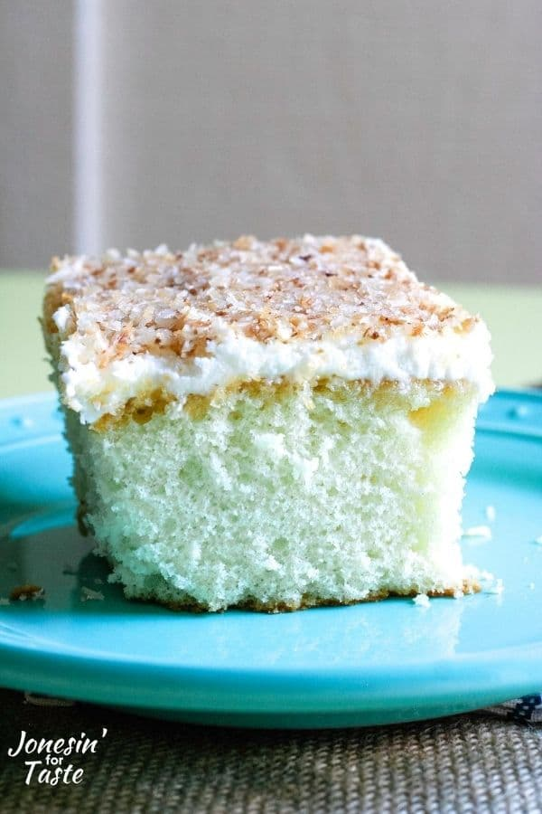 a coconut cake topped with coconut frosting and toasted coconut