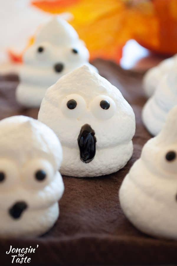 A group of ghost meringues on a brown tea towel