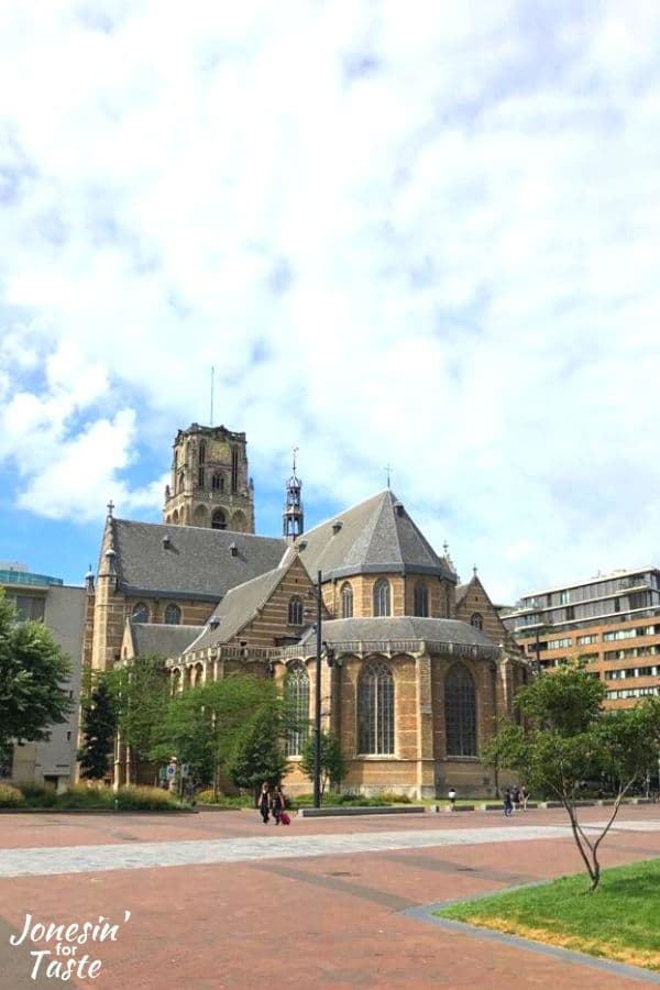 a picture of the Laurenskerk Rotterdam on a sunny day with blue skies and white clouds
