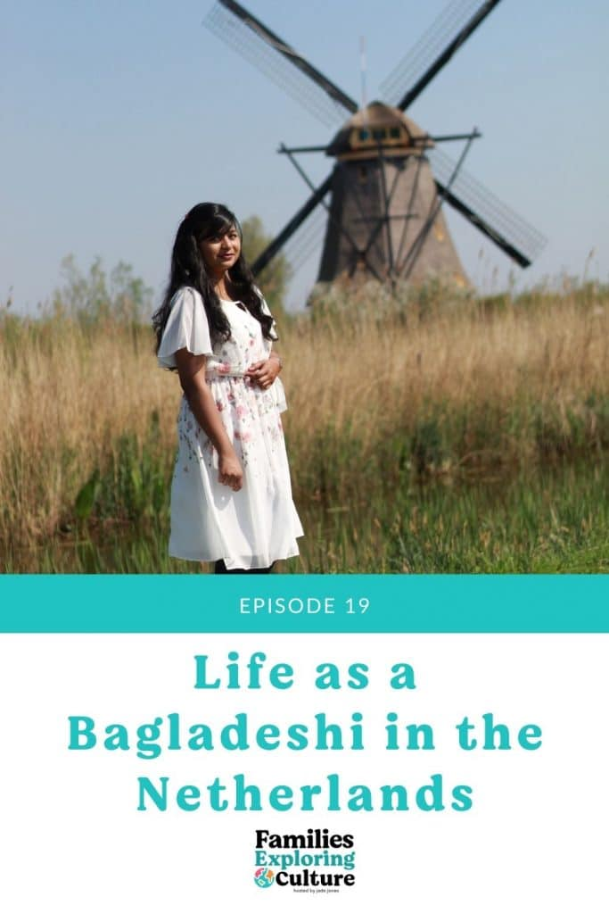 a picture of Neela posing in a white dress with a windmill in the background.