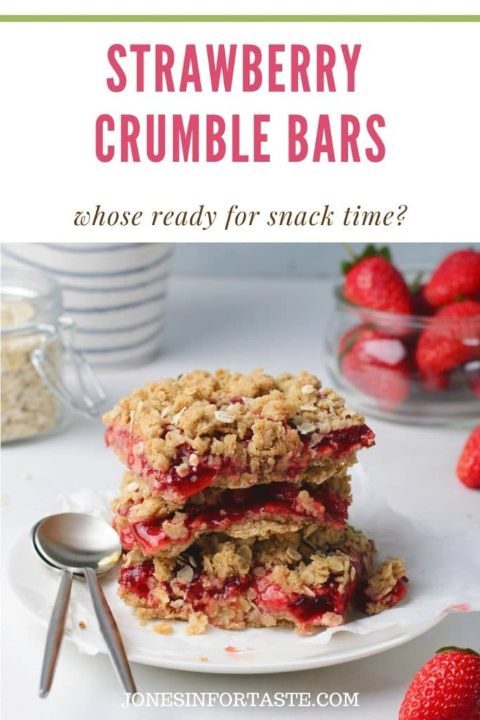 3 strawberry oatmeal crumble bars stacked on a white plate with containers of fresh strawberries and oatmeal around it