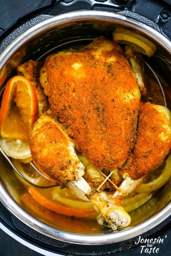a cooked whole chicken in a pressure cooker pot