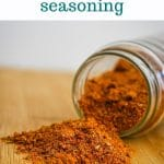 spices spilled out of a jar that is tipped over on its side on a cutting board, text above the photo says make your own taco seasoning