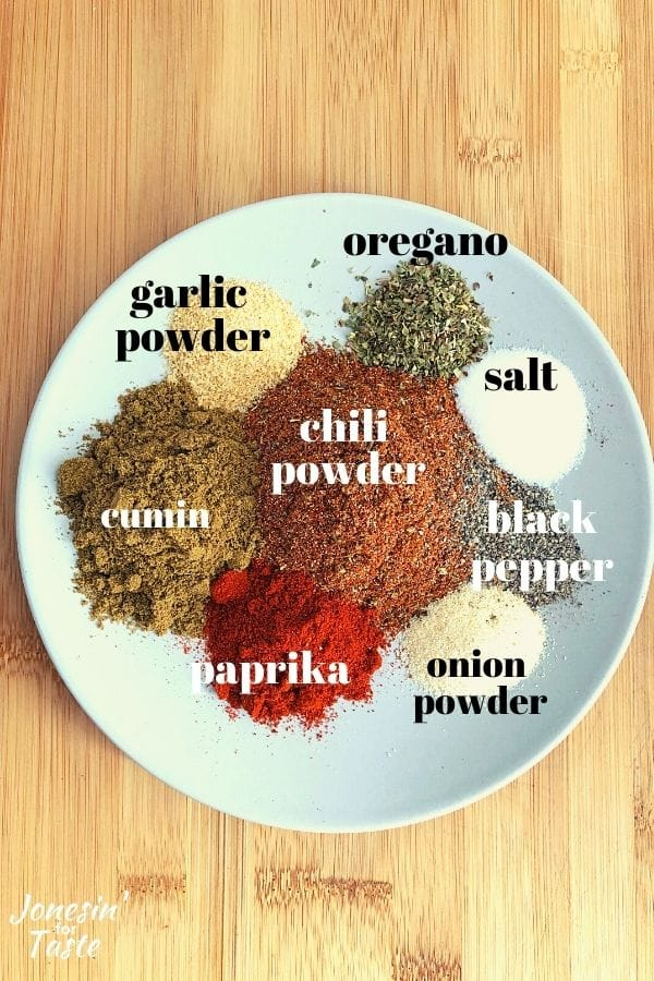 small piles of different spices on a plate